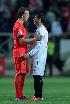 Ivan Rakitic (L) of FC Barcelona embarces Jose Antonio Reyes (R) of Sevilla FC after the La Liga match between Sevilla FC and FC Barcelona at Estadio Ramon Sanchez Pizjuan on April 11, 2015 in Seville, Spain.