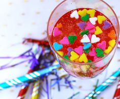 Cupcake Champagne Cocktail  - Fashionably Bombed (Fruit Martini Maraschino cherries Sprinkles Simple syrup Butterscotch schnapps Vanilla bea...