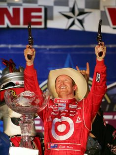 June 7, 2008: Scott Dixon, driver of the #9 Target Chip Ganassi Racing Dallara Honda, fires the Beretta Stampede pistols in Victory Lane after winning the IRL IndyCar Series Bombardier Learjet 550k.