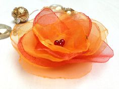 Hey, I found this really awesome Etsy listing at https://www.etsy.com/listing/125035880/organza-fabric-flower-hairclip-orange