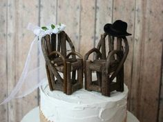 Instead of the traditional bride and groom wedding cake topper, opt for mini wooden chairs with appropriate bride and groom accessories. #countrywedding http://www.gactv.com/gac/photos/article/0,3524,GAC_42725_6075192_01,00.html?soc=pinterest