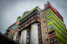 unused grain silos topped with shipping containers = student housing in johannesburg