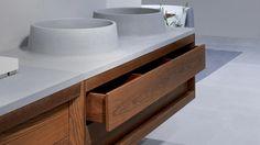 Dogi bathroom by GD Cucine - Natural heat-treated ash-wood vanities.Serena stone countertops and washbasins