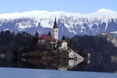 Bled Lake and Assumption of Mary Pilgrimage Church. You can see the fantastic snow-covered Julian Alps behind Bled Island's church.