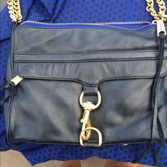 Rebecca Minkoff Black MAC w/ Blue Zipper Black thick buttery leather and a blue zipper tape. Brass hardware does show some rubbing and some makeup residue on bottom of interior. Comes with dustbag. Great every day bag Rebecca Minkoff Bags