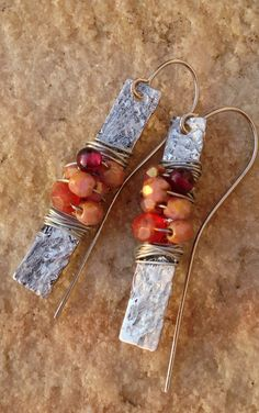 Earrings: textured metal slice. Beads and wire wrapped around it. Punch a hole for the earwire and Boom.