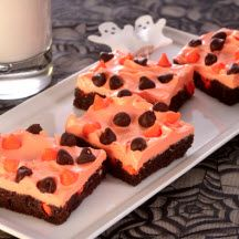Halloween Brownie Bars - Easy and fun Halloween brownies topped with orange frosting and colored chocolate morsels. Serve them up at any spooky gathering!