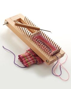 how hard would it be to make a sock loom? Sock Loom by Knitting Board from Lion Brand Yarn Knitting Loom Socks, Knifty Knitter, Loom Knitting Projects, Loom Knitting Patterns, Crochet Patterns, Knitting Loom Instructions, Knit Socks, Loom Weaving, Weaving Tools