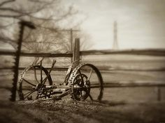 Antique Farm Machinery. Old horse drawn lawn mower. Antique Lawn Mower.   Sepia Photography. Fine Art Photography.   Antique Lawn Mower - Copyright 2012 Dawn Mercer, Canadian Artist