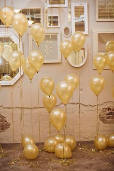 Loving this gold balloon set up - possibly for a photo booth back ground?