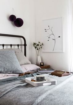 cozy neutral bedroom with grey bedding and white walls