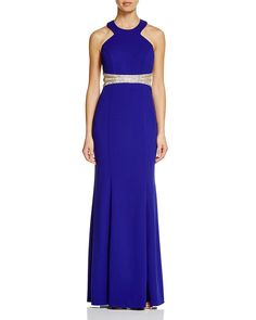 Time to shine in this Decode 1.8 Sleeveless Embellished Waist Gown! A jeweled midsection and open back are tastefully fit for any formal occasion.