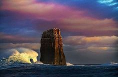 The 30m majestic tower of Eddystone Rock standing proud in the turbulent waters off of South East Cape.  The Rock, known for its inaccessibility and distinct shape, was named by Captain James Cook in 1777 because he thought it resembled Eddystone Lighthouse in Devon, England.