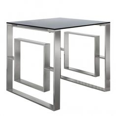 With a stainless steel base this side table that will perfectly simmer in the light and reflect your current interior this side table is topped off with a lovely smoked glass table top.   #glassfurniture #glassinterior #glassinteriors #glassinteriordesign #furnituredesign #vintagefurniture #inspohome #betterhomesandgardens #antiquefurniture #luxuryinteriors #luxurydecor #passion4interior #styleathome #roomforinspo #homesdirect365 #homeinspiration #decor