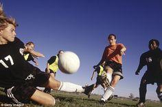 Teens playing soccer