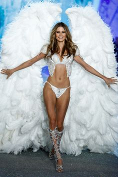 Would adding Behati's breathtaking wings to our wish list be that unreasonable? We don't think so.