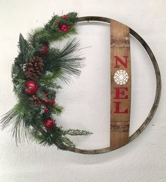 Items similar to Christmas Wreath wine barrel ring & stave on Etsy Wine Barrel Crafts, Wine Barrel Rings, Rustic Christmas, Christmas Wreaths, Christmas Decorations, Christmas Ring, Etsy Christmas, Christmas Music, Christmas Movies