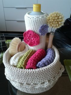 Homemade basket with soapcoat and cloths.