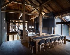 Villa Solaire in Morzine, France by JKA + FUGA.  Heavy timber, dark walls, and punched niches in the walls.
