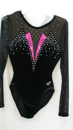 Just like the TAMU club leotard, except the body is maroon/red, the sleeves are white, and the metallic pink piece is silver.
