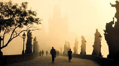 Prague ~ Charles Bridge: commissioned by King Charles 1V in 1357, spanning 16 arches and 30 Baroque statues.