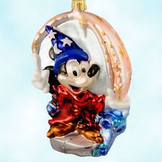 "This Disney Christopher Radko Fantasia Sorcerer's Apprentice Mickey Mouse ornament.  Produced in 1998 as part of the ""Mickey Mouse-70 Happy Years"" set, with a limited edition of 1928 pieces for the year Mickey was born, this Polish mouth blown glass ornament soon retired, making it a rare collectible find.  Mickey enchanted brooms to do his chores. The broom brigade marches up the stairs, spilling buckets of sparkle-dusted water with every step. He shows off with a jet of pink magic."