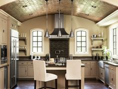 Rustic, yet comfortable and contemporary atmosphere accomplished with reclaimed hardwood floors, brick barrel vaulted ceiling, stainless steel LaCanche range, and custom stainless hood.