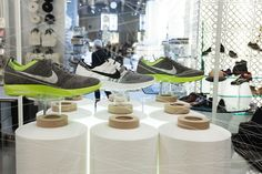 Store display for Nike's Flyknit shoes, made by knitting the entire upper of the shoe as a single piece. The display plays off of the new technology by incorporating giant spools of thread and making the shoes appear to be suspended by thread.