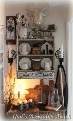 Love all the white and black and white finish on shelf.