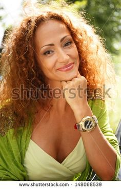 Beautiful Middle-Aged Redhead Smiling Woman Outdoors Stock Photo ...