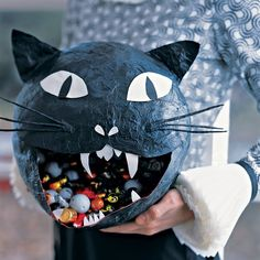 It's easy to adapt our bat pinata technique to make a creepy cat. All you need is a few more materials and you'll have a festive feline in no time.