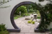 These windows frame particular views of the garden for people on the walkway. Gateways in unusual shapes also frame views.