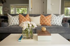 love that gray sofa with colorful pillows!