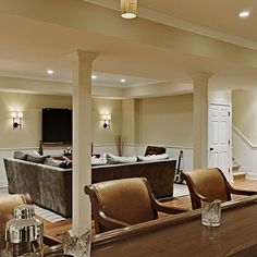 Support Pole Ideas  -  New York Traditional Home Basement Design Ideas, Pictures, Remodel, and Decor