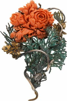 Coral, Brass, Sterling Silver Brooch, Stephen Dweck The brooch features a carved pink coral flower measuring 40.00 x 43.00 mm, set in brass and sterling silver, completed by a pinstem and catch on the reverse, marked Stephen Dweck. Gross weight 62.95 grams.