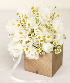 White Tulips & Chamomile: It's not just for your tea. This springtime mix of chamomile and tulips gives off a casual vibe, which is great if you want to re-create the look yourself.
