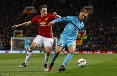 Manchester United defender Phil Jones, back in the team after a long injury lay-off, puts ...