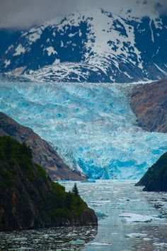 Sawyer Glacier reflecting in the ice peppered river, Inside Passage, Tracy Arm Fjord, Alaska   Copyright Jason Schlosberg
