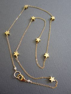 Hey, I found this really awesome Etsy listing at https://www.etsy.com/listing/124214817/7-tiny-star-necklace-star-necklace