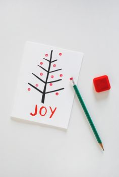 Eraser-Stamped Homemade Christmas Cards   Send your little one off to school with these custom Christmas card ideas that they can personalizes themselves.