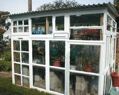 Since windows are (literally) built to be a bridge between the indoors and outside, they can stand up to weather, which makes them perfect for use in the garden. I love the greenhouse above, built entirely from recycled windows salvaged from a neighborhood remodel by Cheft. @bobvila.com