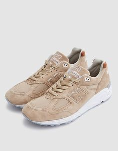 Classic low top sneaker from New Balance in Tan and White. Pig suede and mesh upper. Lace-up front with flat woven laces. Lightly padded tongue and collar. ABZORB® midfoot cushioning. Removable insole. Tonal stitching. New Balance branding throughout. Rub