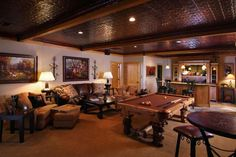 """Pool table, bar and punched tin ceiling.  Can't think of a better way to finish off the """"man room""""."""