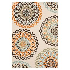 Indoor/outdoor rug with a medallion motif.   Product: RugConstruction Material: PolypropyleneColor: Cr...
