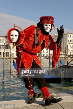 Stockfoto : Male mask with red harlequin costume at carnival in Venice