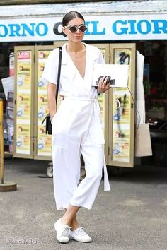 Photos via: Lee Oliveira | Grazia Russia Behold! Another inspiring look from street style star Diletta Bonaiuti. This time, she's ready for the hot weather in a cute, white jumpsuit that she keeps sim