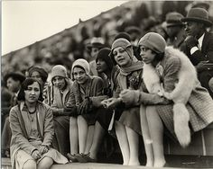 Black flappers enjoying a football game at Howard University, 1920's