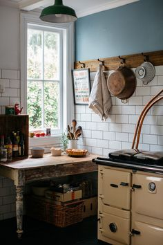 Nail a wood plank to the wall and then get those black hooks for pots and such
