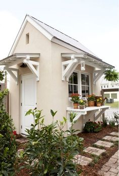 Southern Living Sugarberry plan garden shed -- I like the awnings and the workbench