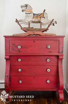 "A red dresser painted by ""Miss Mustard Seed"". I think I absolutely love everything she does!"